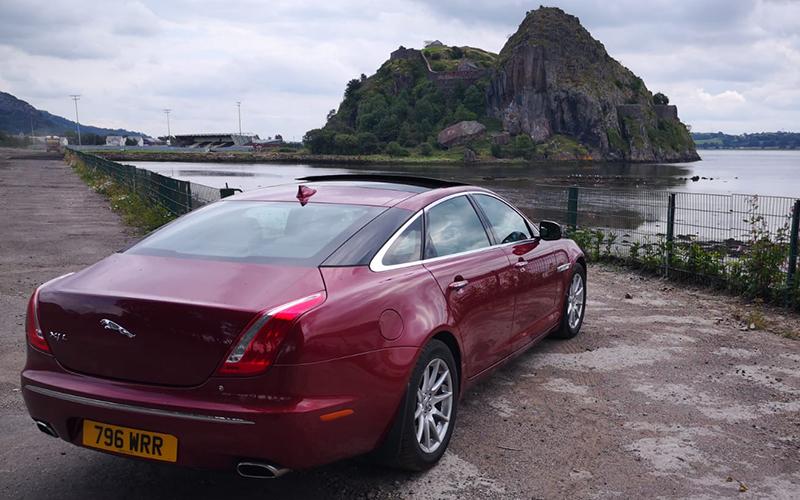 Luxury Jaguar XJL overlooking water